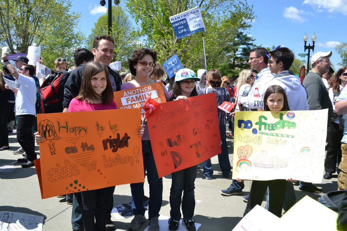 Rally family with signs